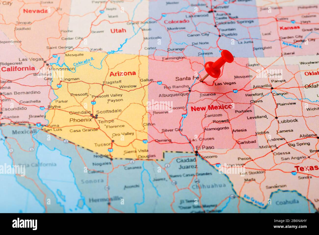 Santa Fe Us Map Red clerical needle on a map of USA, New Mexico and the capital of