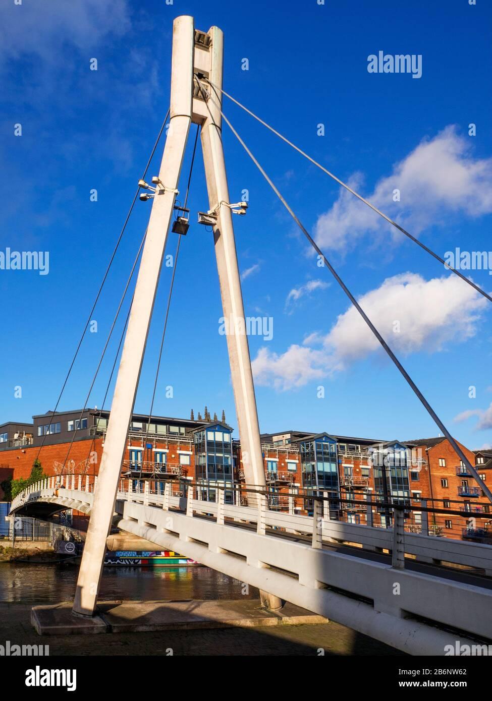 Centenery Bridge a modern pedestrian bridge over the River Aire in Leeds West Yorkshire England Stock Photo