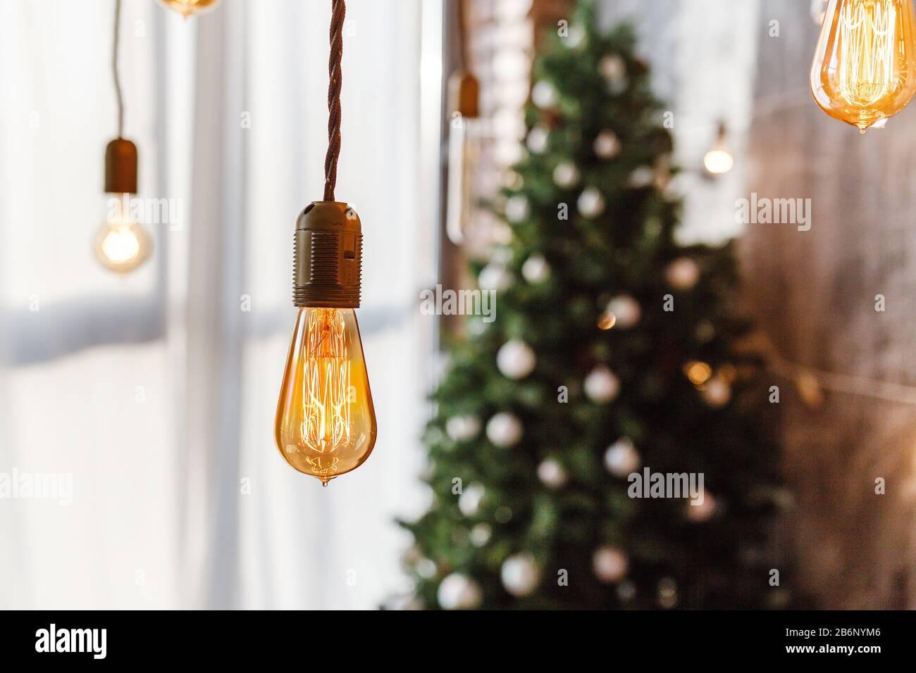 Christmas Tree And Modern Edison Light Bulbs Handing Stock Photo Alamy