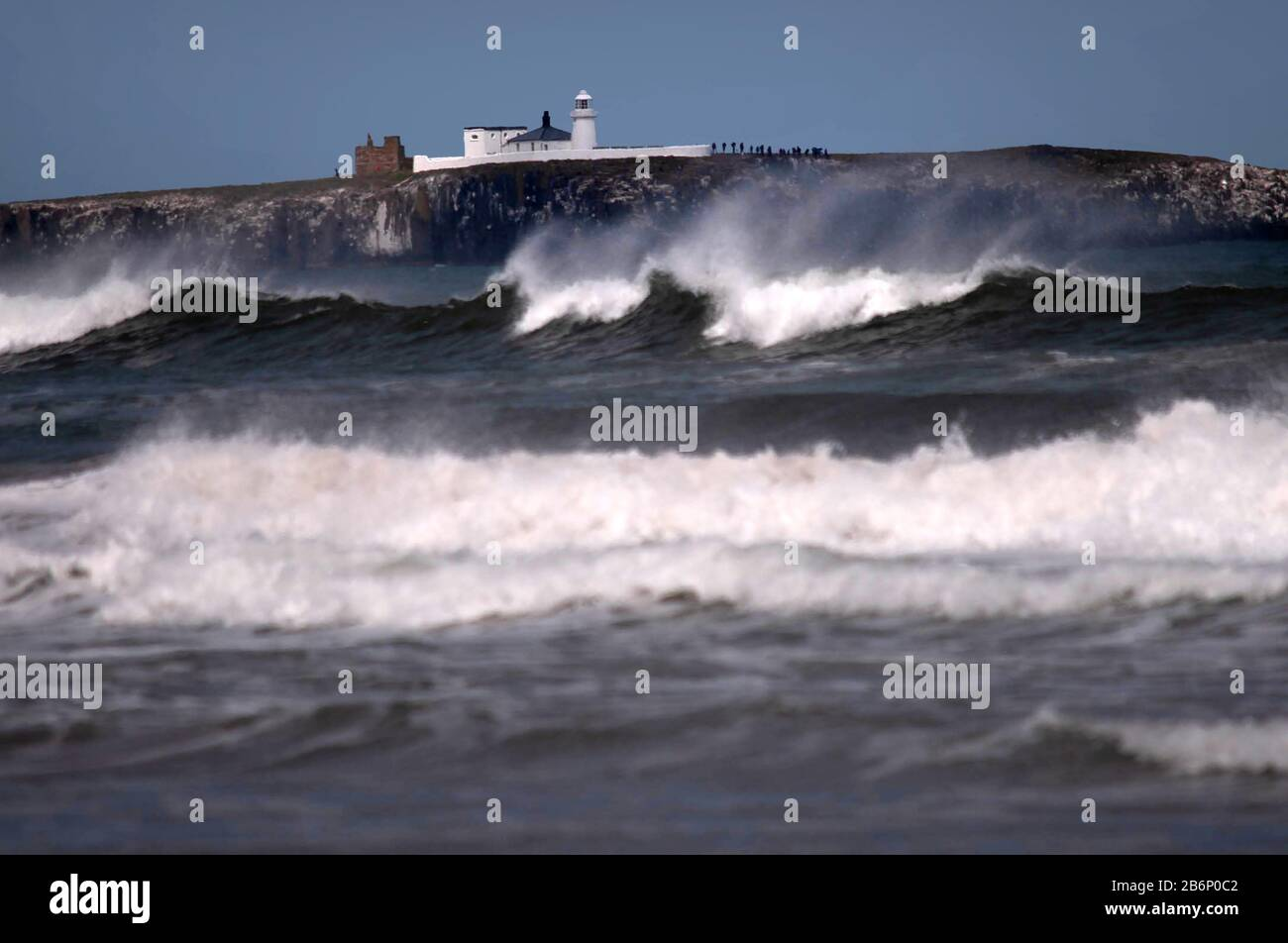 Farne Islands seen from Seahouses on a stormy day Stock Photo