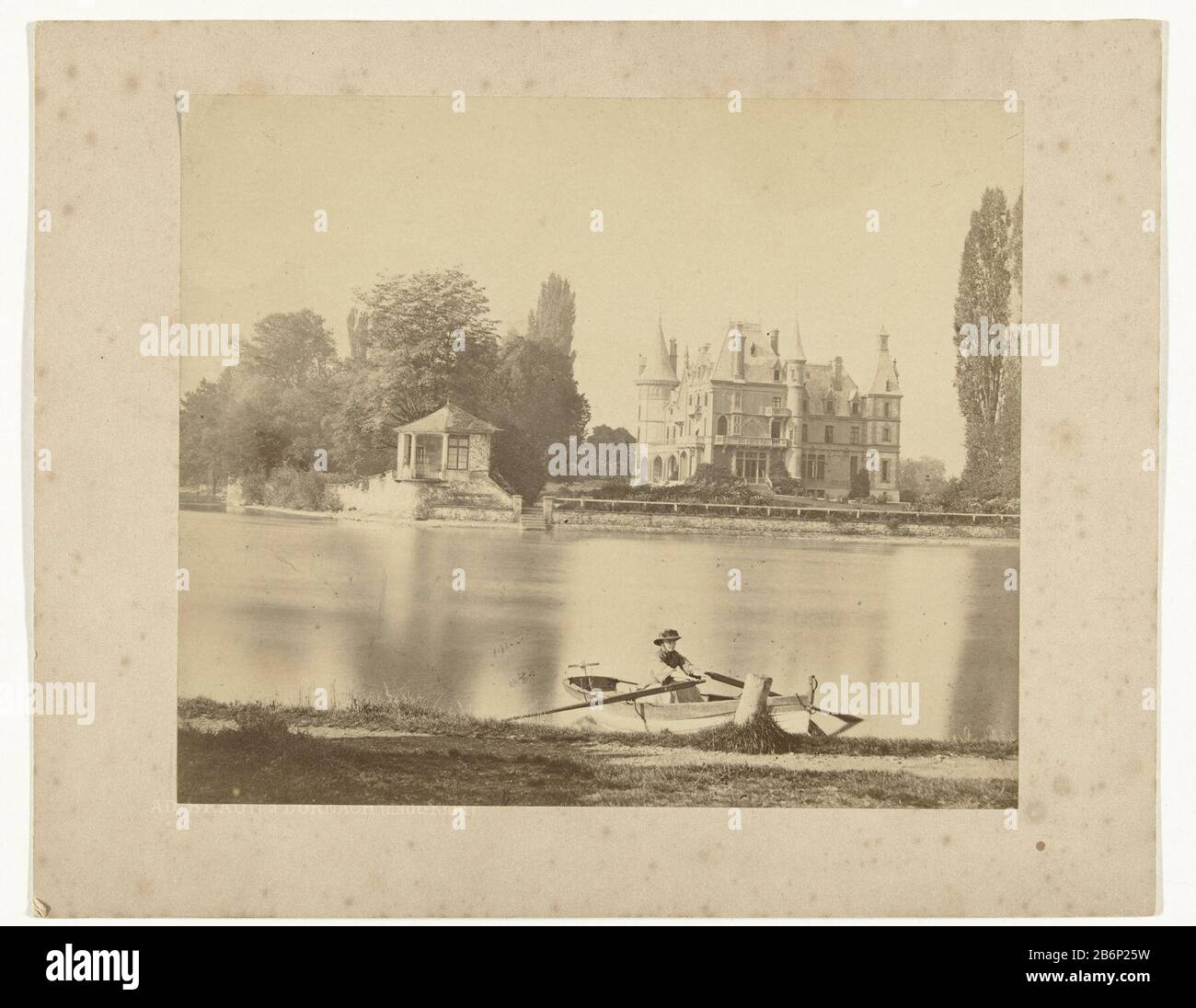 "Gezicht een landhuis, een rivier en een roeiboot met daarin een vrouw View of a country house, a river and a row boat containing a female object type: picture Item number: RP-F 2002-80 Inscriptions / Brands: signature, recto, printed: ""AD. BRAUN à DORNACH (Haute-Rhin) Manufacture Creator: photographer Adolphe Braun et Cie (listed property) Place manufacture: Dornach Dating 1865 - 1885 Physical features: albumen print material: paper paper cardboard Technique: albumen print dimensions: photo: H 159 mm × W 189 mmblad : h 200 mm × W 252 mm Subject: rowing-boat, canoe, and etc. Stock Photo"