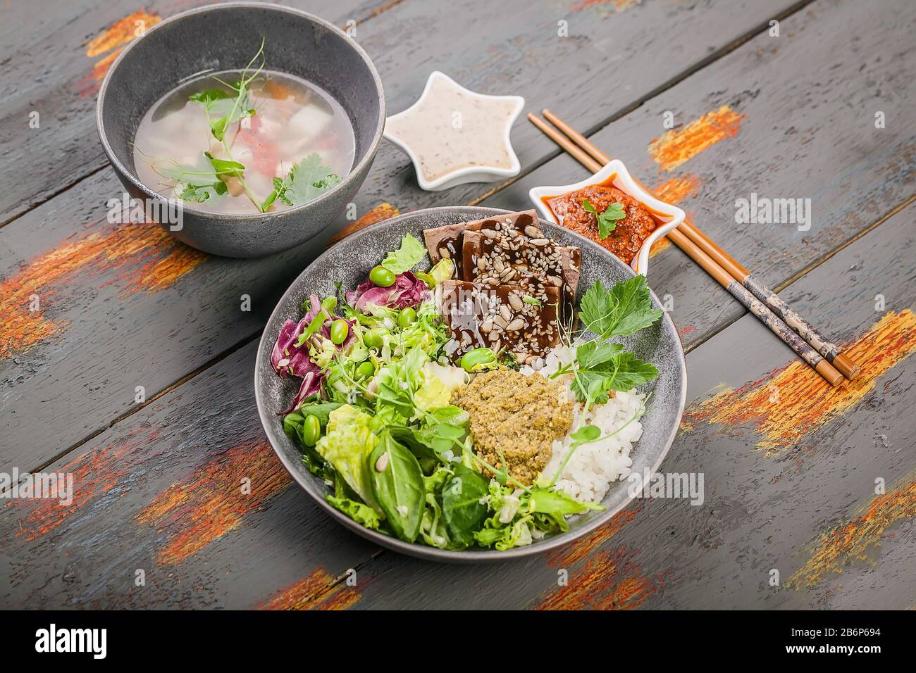 Organic Asian Healthy Food Buddha Bowl With Salmon Fish Soup Salad Rice With Pesto Spinach Leaves Green Beans Beef With Teriyaki Sauce Close Up Stock Photo Alamy
