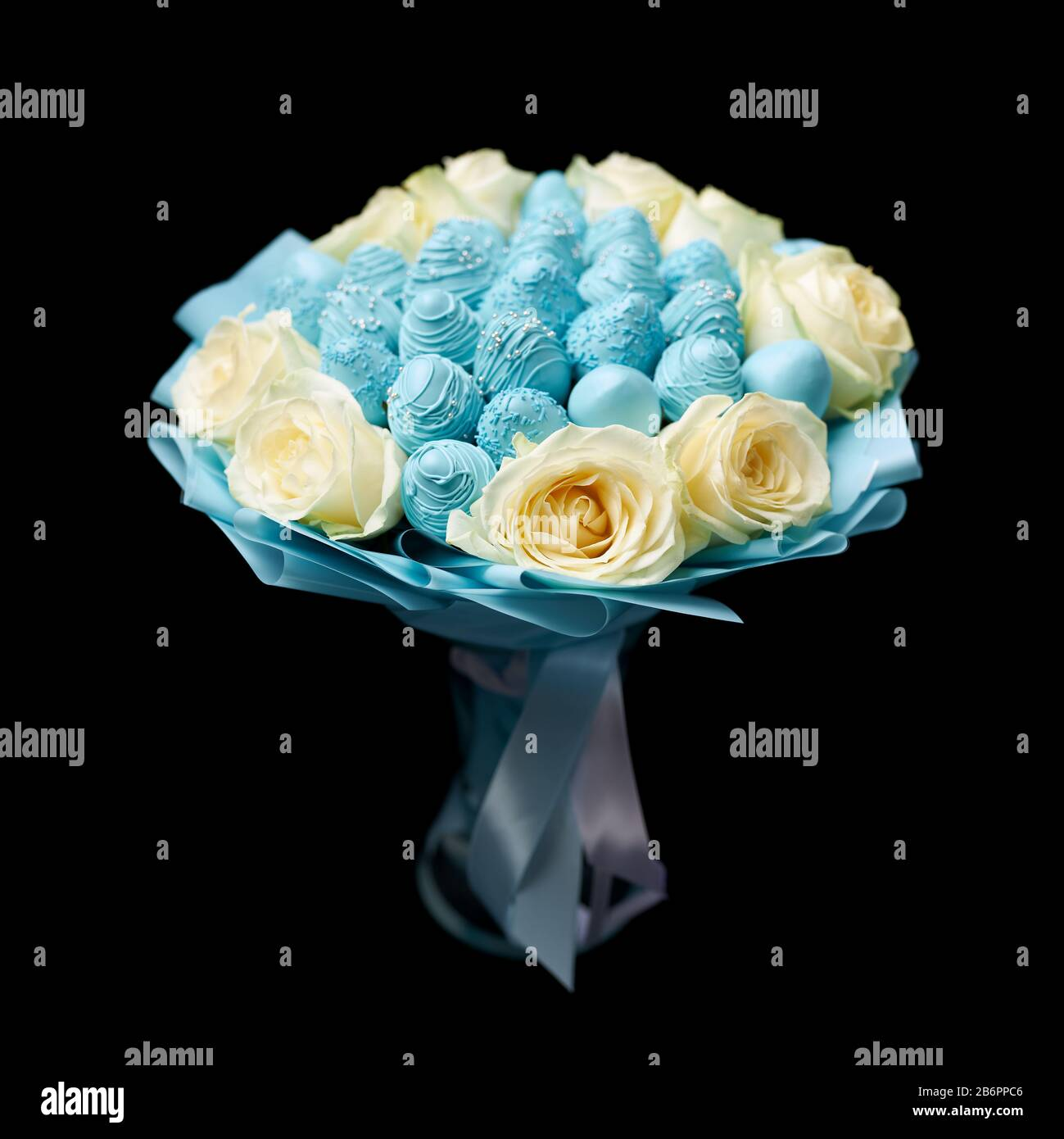 Unique Bouquet Of White Roses And Ripe Strawberries Covered With Blue Chocolate Stands In A Vase On A Black Background Stock Photo Alamy