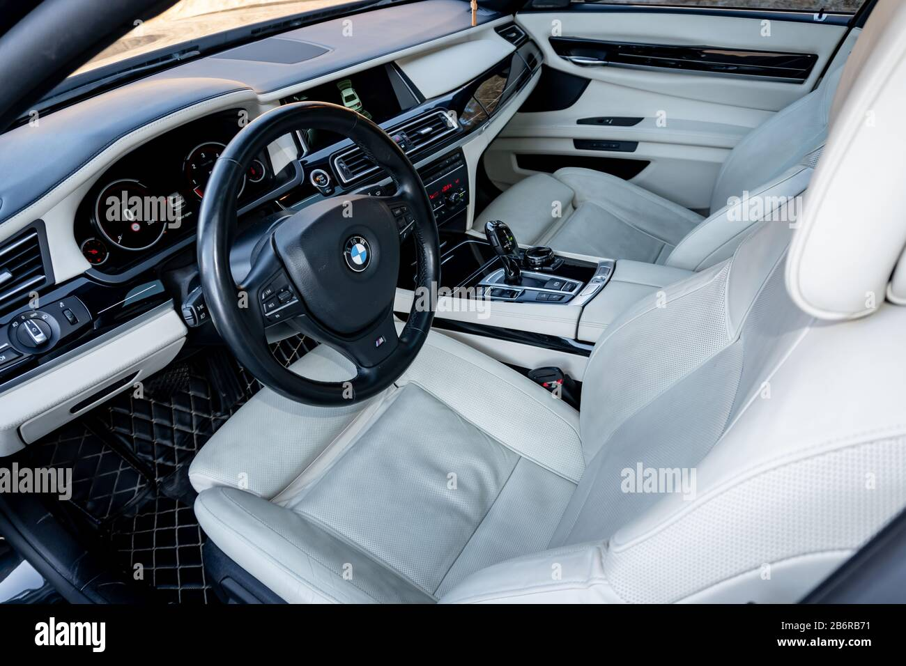 White Leather Interior Seats And Dashboard Inside A Luxurious Bmw 750d Black Limousine With 381hp Hi Tech Comfort Equipment M Package And Individual Stock Photo Alamy