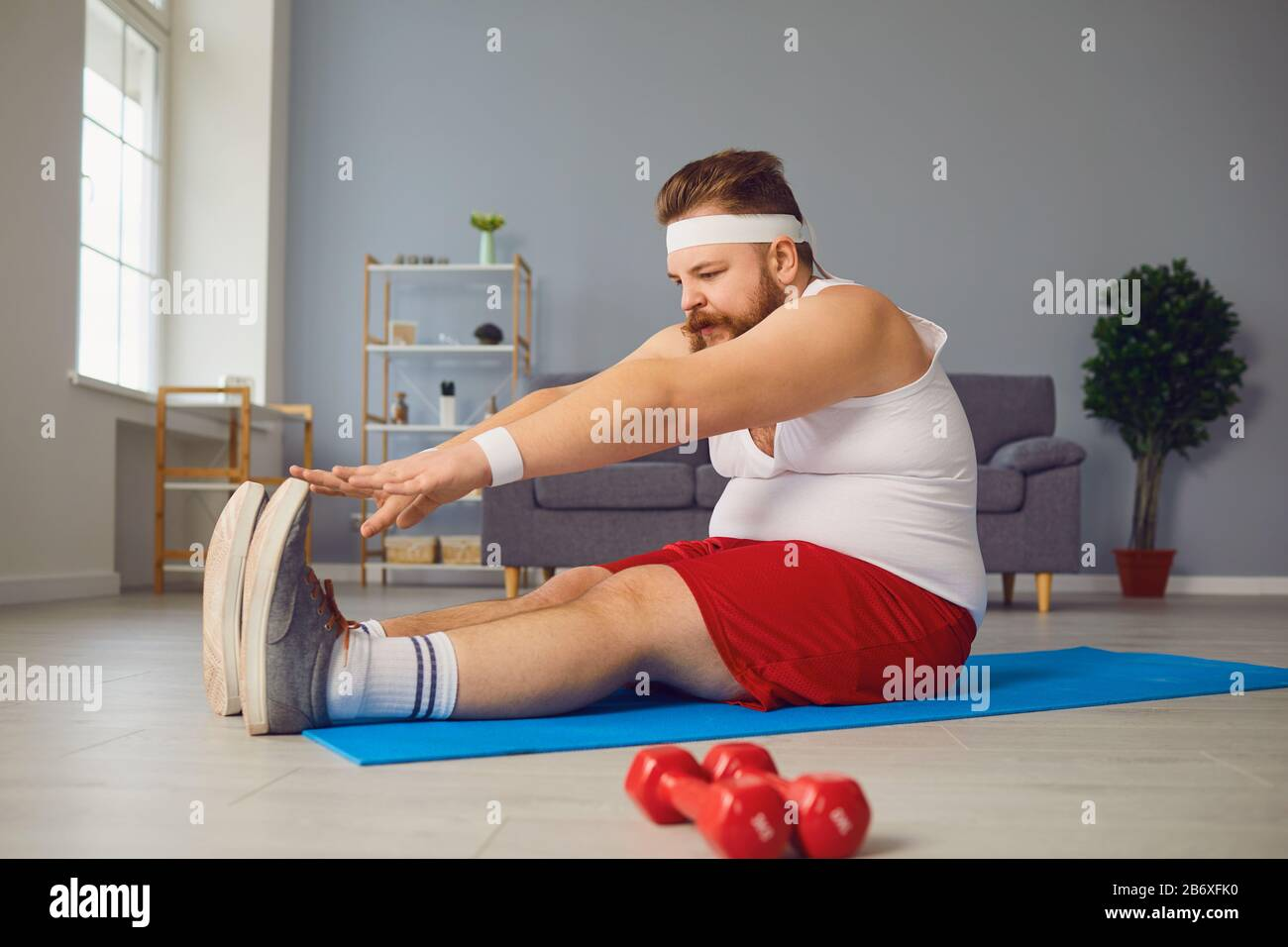 Funny Red Fat Man Doing Exercises On The Floor While Standing At Home Stock Photo Alamy