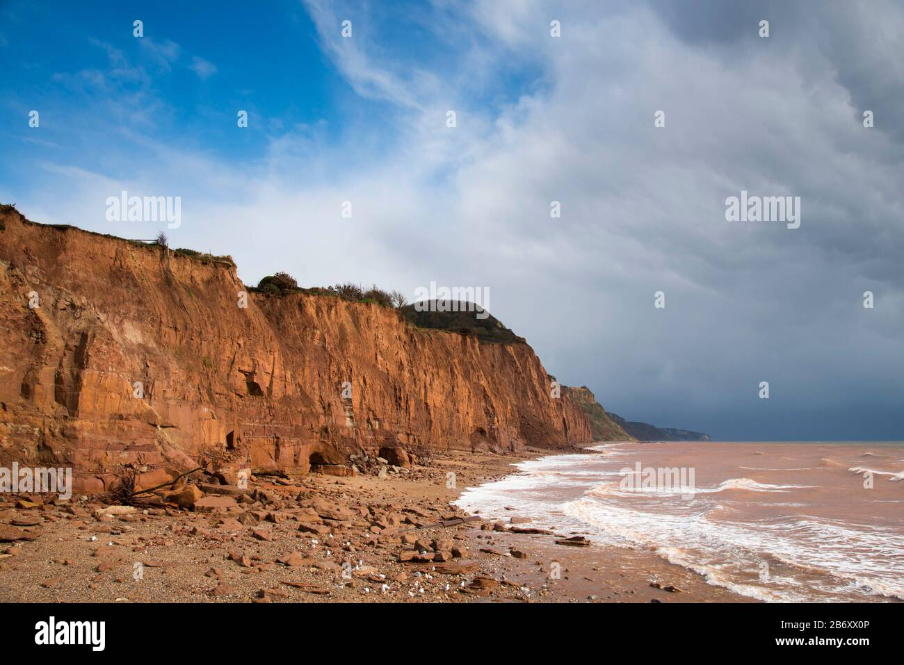 Sidmouth, Devon, UK.  12th March 2020.  UK Weather.  View of the eroding cliffs East of Sidmouth in Devon on a day of warm spring sunshine and occasional showers where regular landslips are occurring due to the recent stormy weather.  Picture Credit: Graham Hunt/Alamy Live News Stock Photo