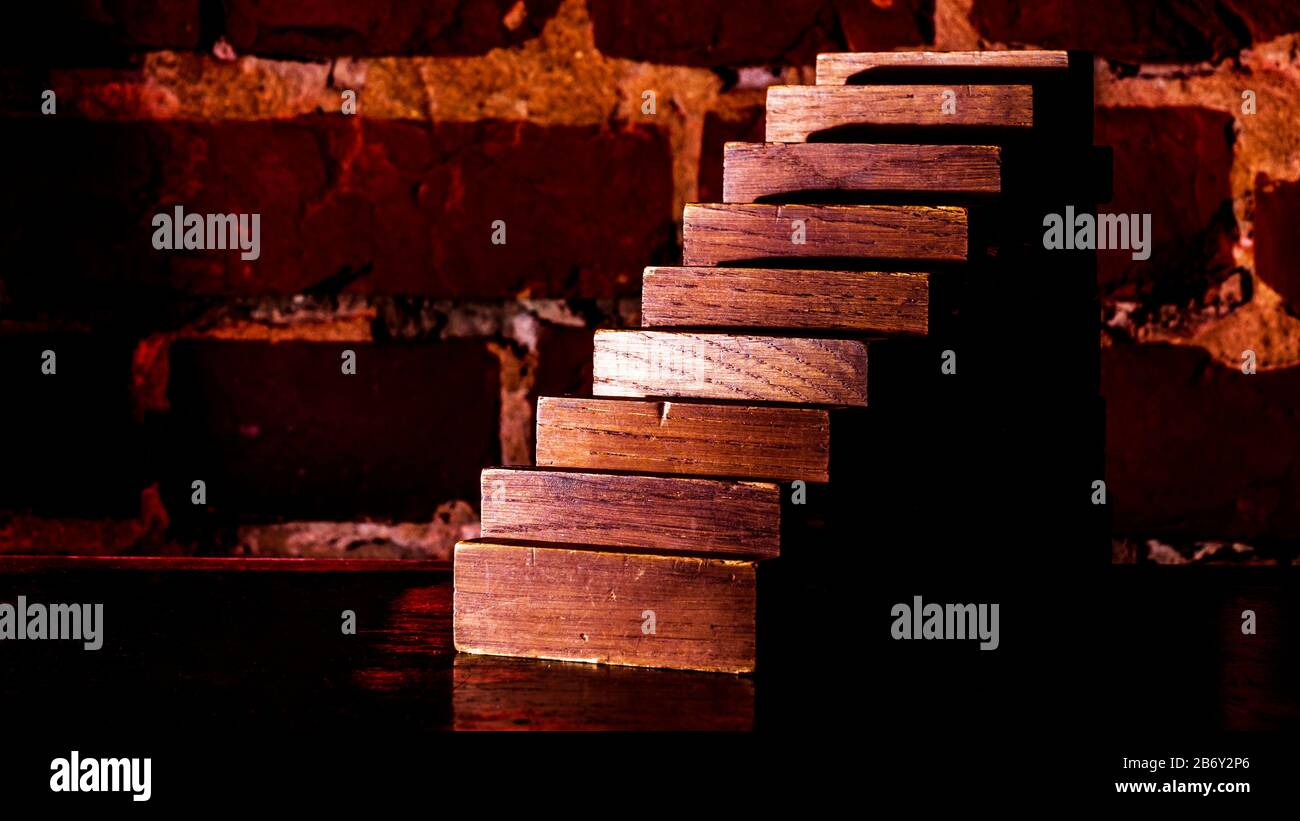 Business risk concept with wood plank against the background of a red brick wall. Stock Photo