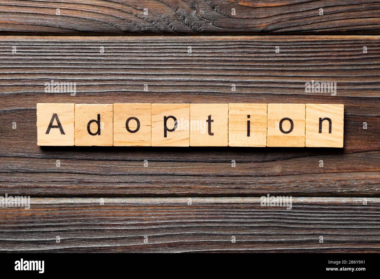 adoption word written on wood block. adoption text on table, concept. Stock Photo