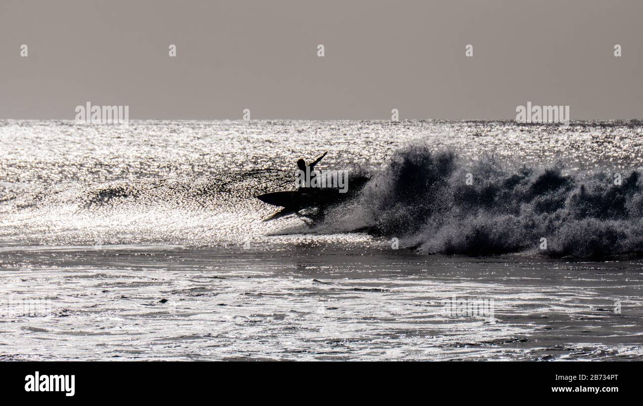 Surfing in Tarrafal, Santiago Island, Cabo Verde, Cape Verde, green islands, Atlantic ocean, Volcano island, Stock Photo