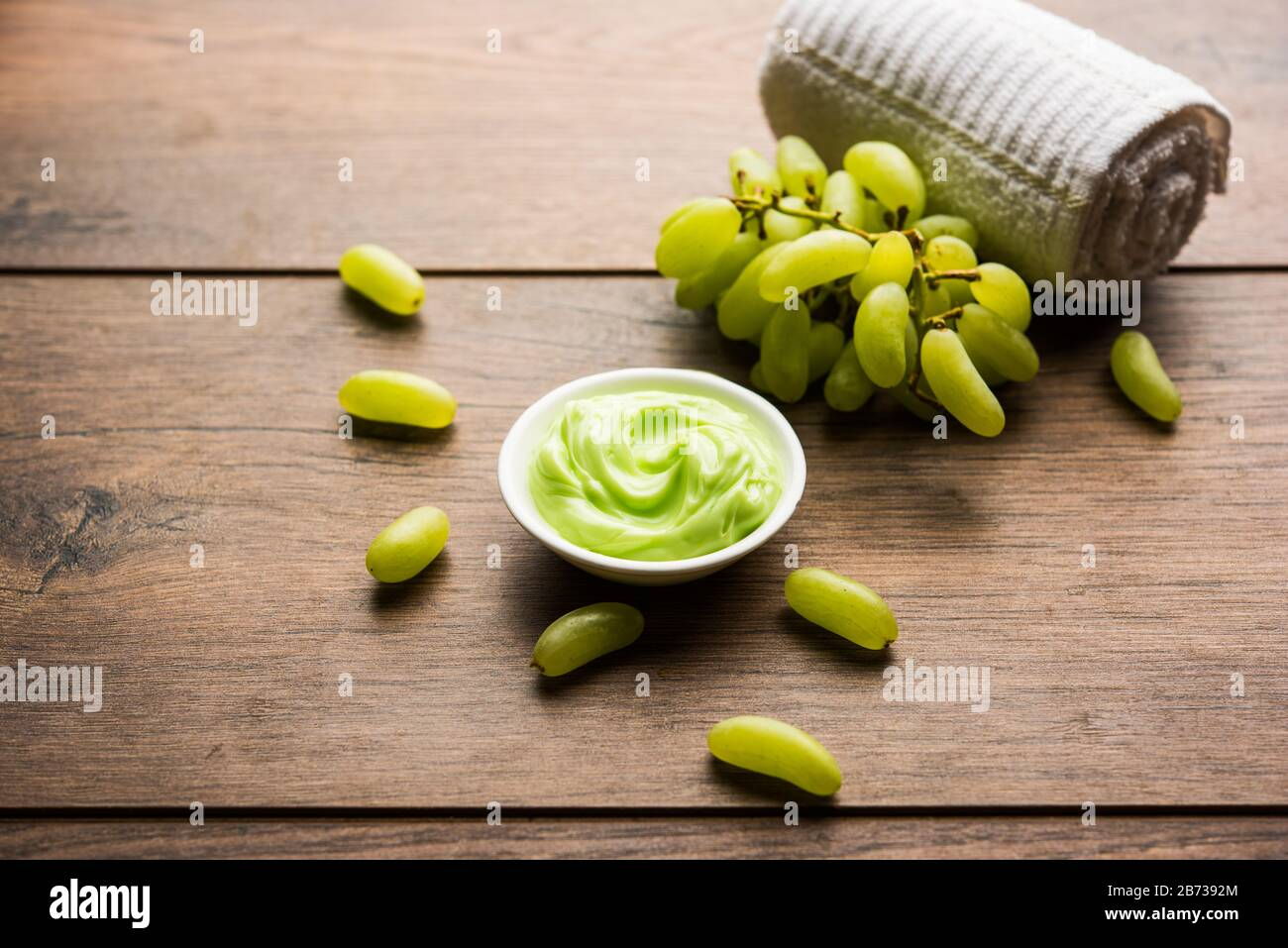 Green grapes, yogurt and honey mix face mask or cream for skin dark spot removal treatment, created using Angoor extract, curd and honey. selective fo Stock Photo