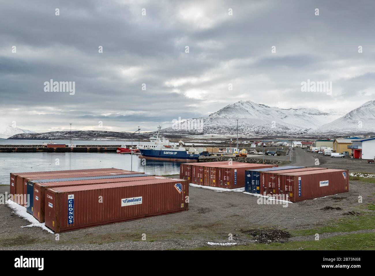 Shipping containers in the little port of Ólafsfjörður in north-east Iceland Stock Photo