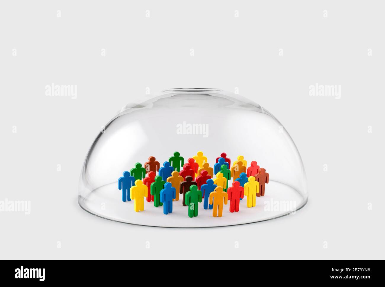 Colorful group of people figures protected under a glass dome Stock Photo