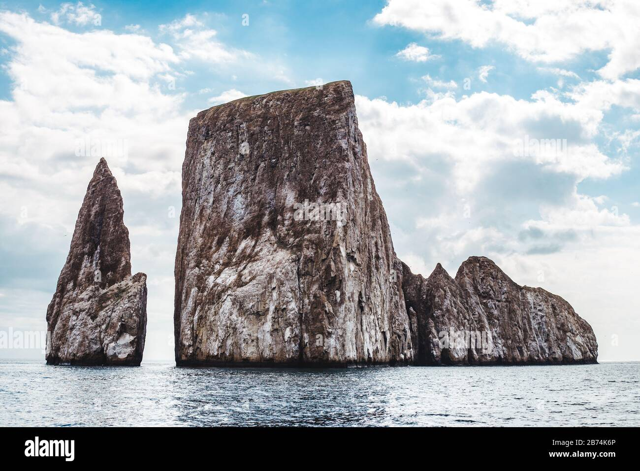 Kicker Rock in the Galapagos Islands, a key snorkeling and diving spot for tourists, with the 300m drop being home to hammerhead sharks, reef sharks, Stock Photo