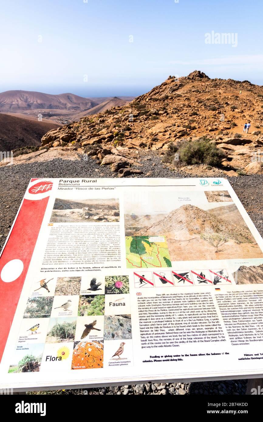 An interpetive panel and the view from Mirador del Risco de las Peñas on the Canary Island of Fuerteventura Stock Photo