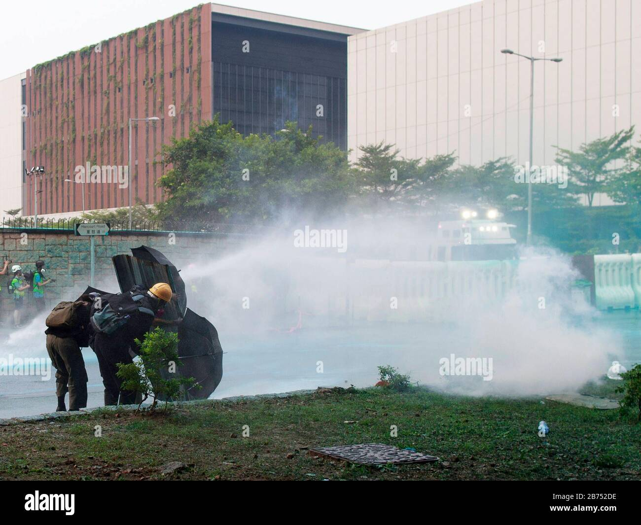 Police use water cannon to disperse protesters at Admiralty. Protesters clash with Anti-riot police during an unauthorised global anti-totalitarian march in Hong Kong, China. Stock Photo