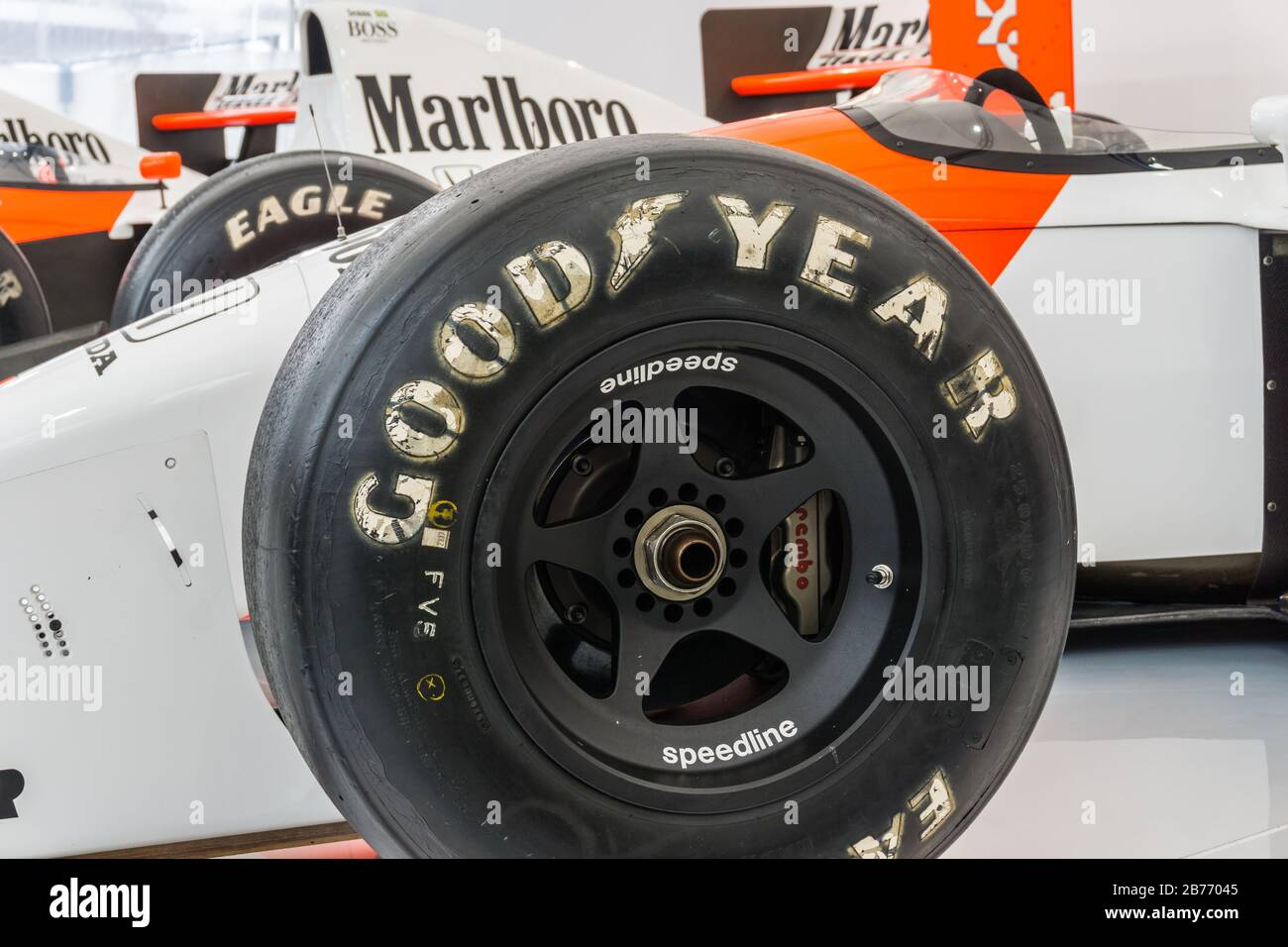 Close up detail of a McLaren Honda MP4/7 in the Honda Collection Hall in Suzuka, Japan, with an MP4-5 in the background. Stock Photo