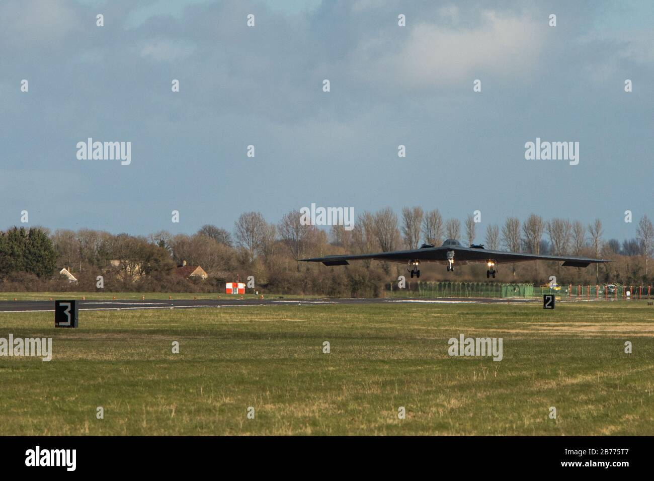 A B-2 Spirit Stealth Bomber, assigned to Whiteman Air Force Base, Missouri, lands at RAF Fairford, England, on March 12, 2020. The aircraft is deployed as part of Bomber Task Force Europe, which tests the readiness of the Airmen and equipment that support it, as well as their collective ability to operate at forward locations. U.S. Strategic Command routinely conducts such operations across the globe to demonstrate U.S. commitment to collective defense as these aircraft, Airmen and key support equipment from Whiteman Air Force Base, Missouri, integrate with Geographic Combatant Command operati Stock Photo