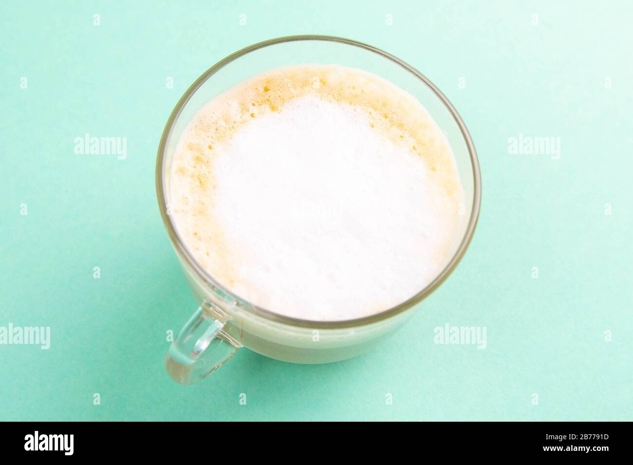 Latte Coffee In Elegant Transparent Glass With Whipped Cream On The Mint Background Stock Photo Alamy