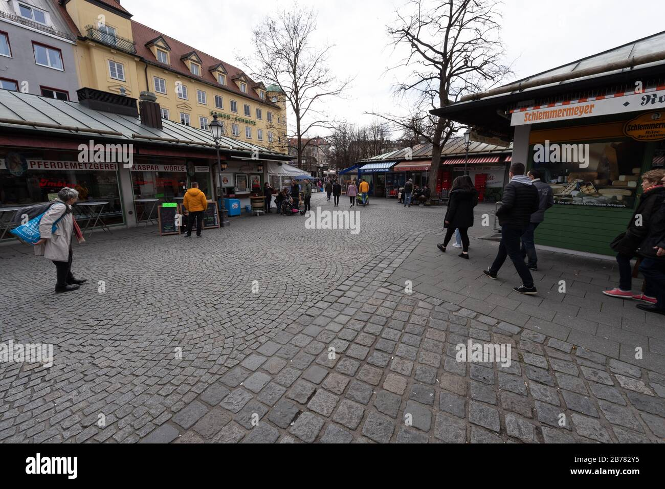 Munich, Germany. 14th Mar, 2020. The Viktualienmarkt, which is otherwise well attended at lunchtime, is only slightly frequented. Credit: Peter Kneffel/dpa/Alamy Live News Stock Photo