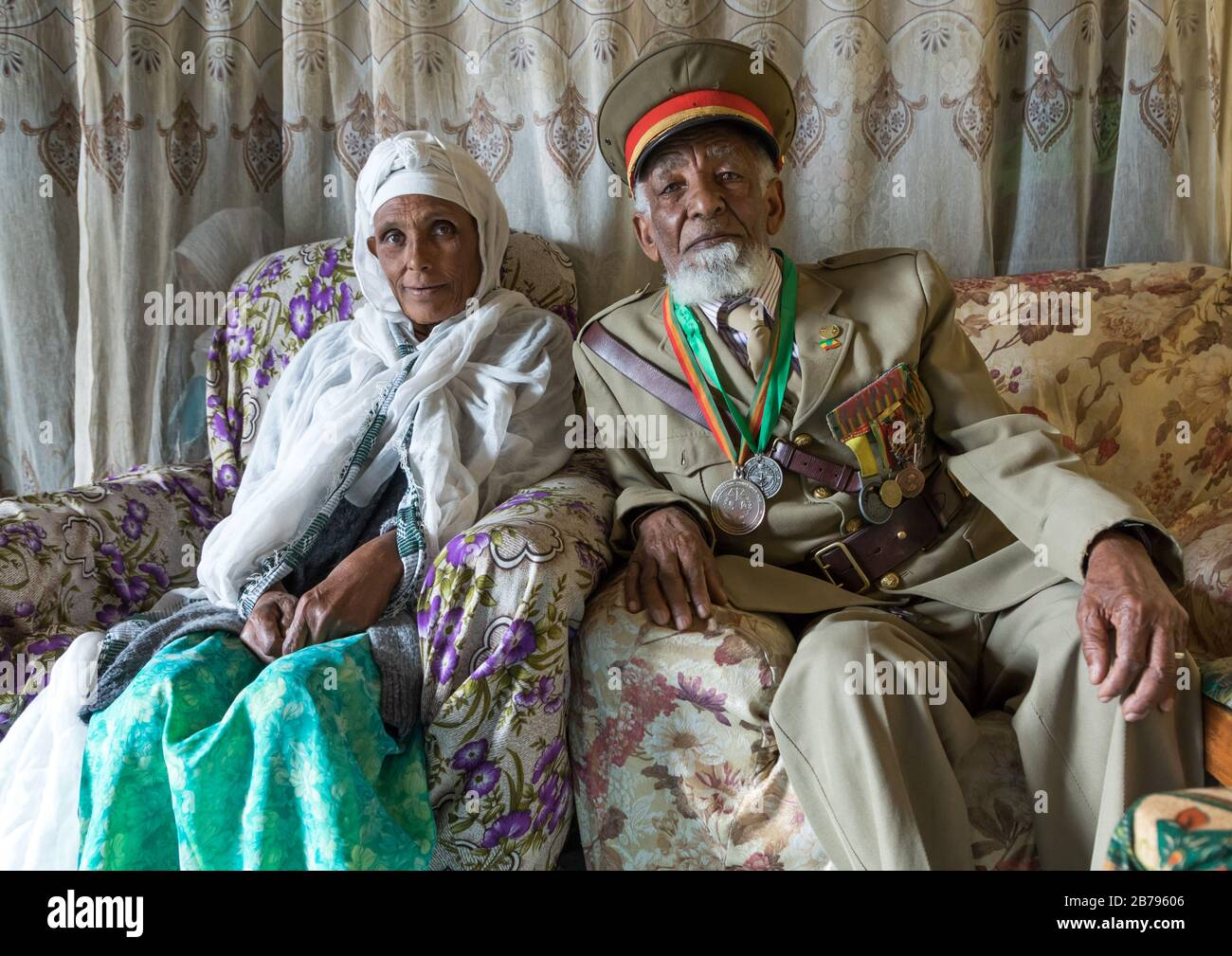 Veteran from the italo-ethiopian war in army uniform with his wife, Addis Ababa Region, Addis Ababa, Ethiopia Stock Photo