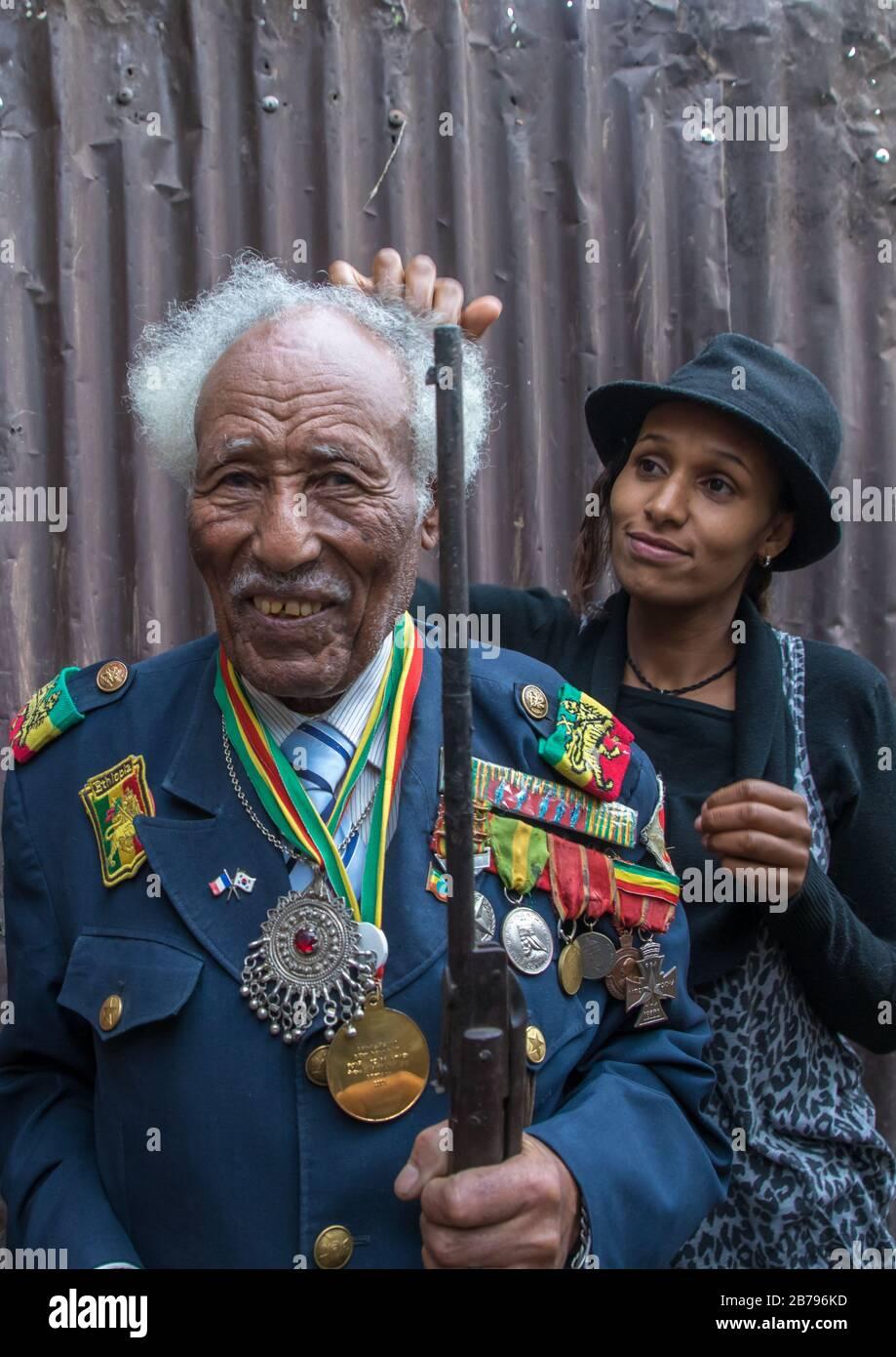 Ethiopian veteran from the italo-ethiopian war with his daughter, Addis Ababa Region, Addis Ababa, Ethiopia Stock Photo