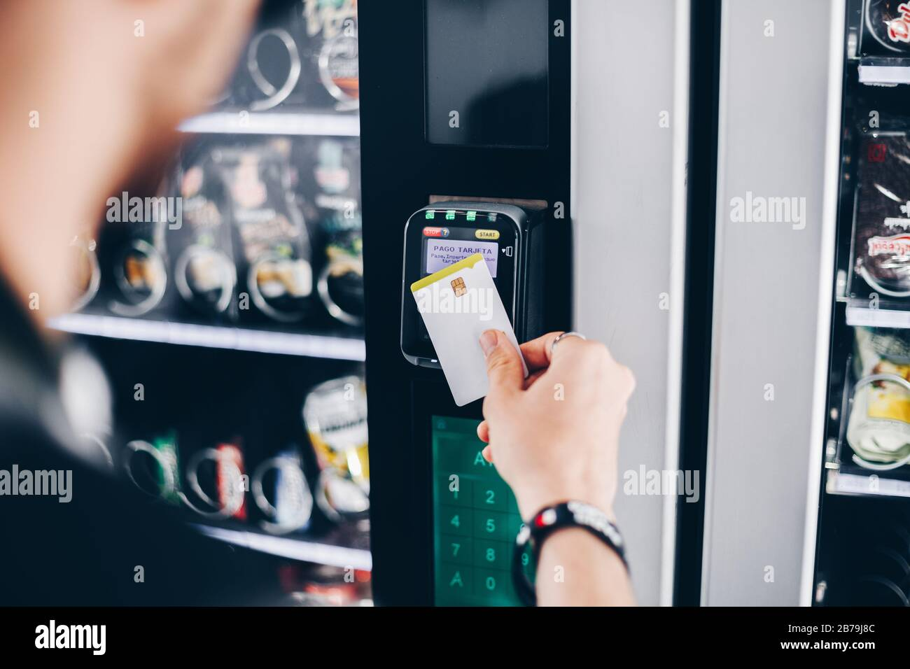 Student using the contactless payment method in a vending machine. Stock Photo
