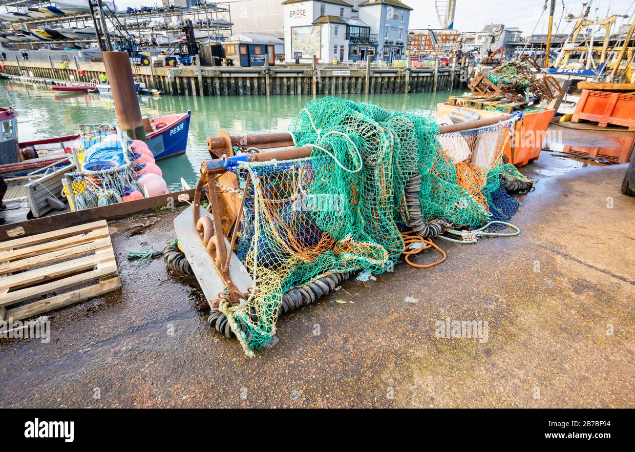 Fishing nets and tackle stored quayside at Camber Quay (The Camber), the ancient port in Old Portsmouth, Hampshire, south coast England Stock Photo