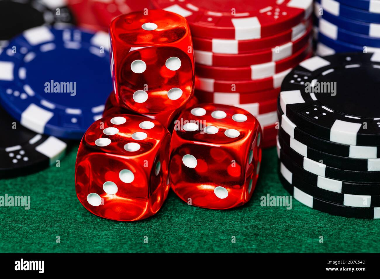 A Macro Of Red Translucent Casino Style Dice With White Pips Surrounded By Reb Blue And Black Betting Chips On A Green Felt Gaming Surface High Deta Stock Photo Alamy