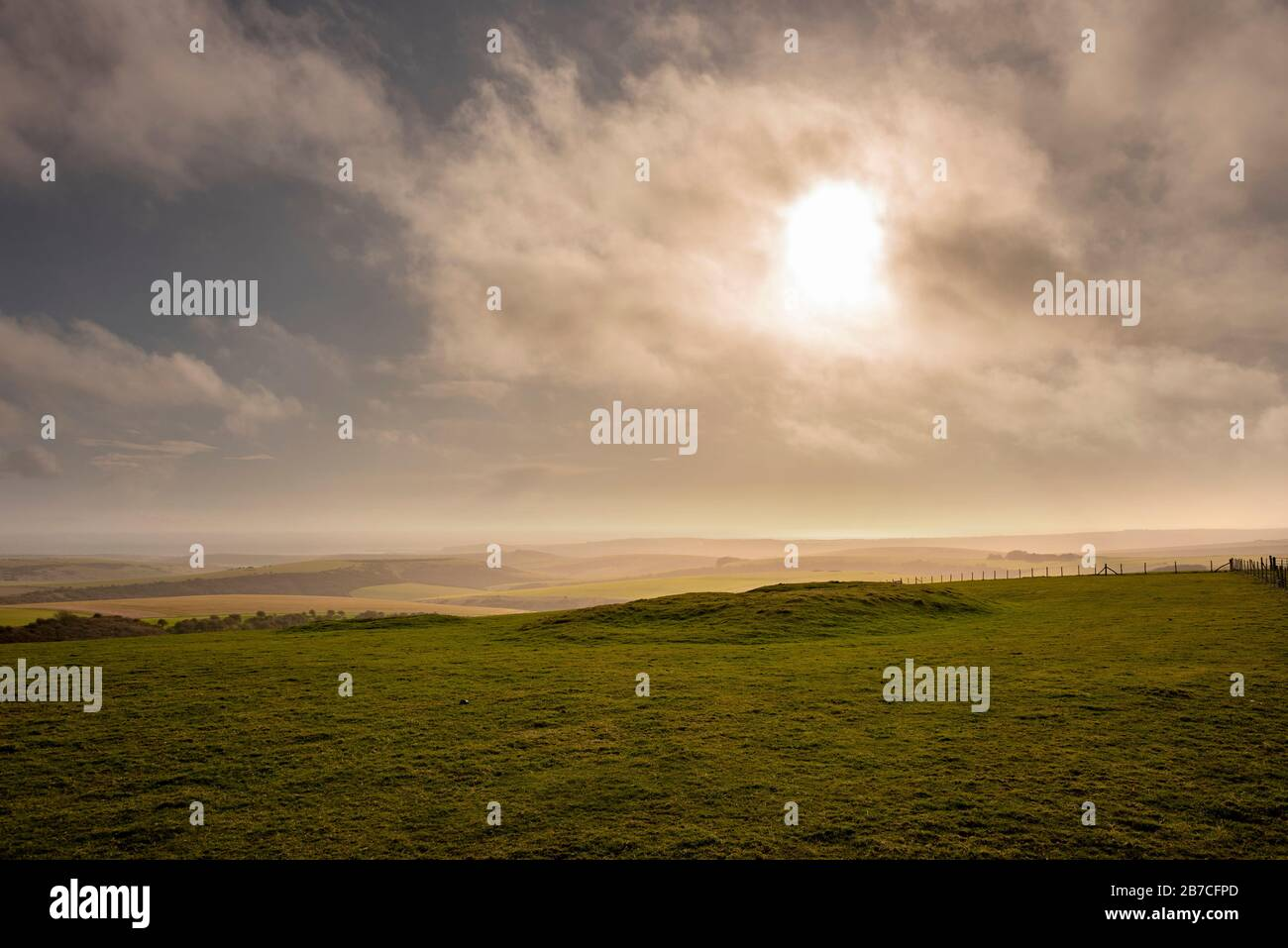 A Neolithic long barrow on Firle Beacon on the South Downs Way, East Sussex, UK Stock Photo