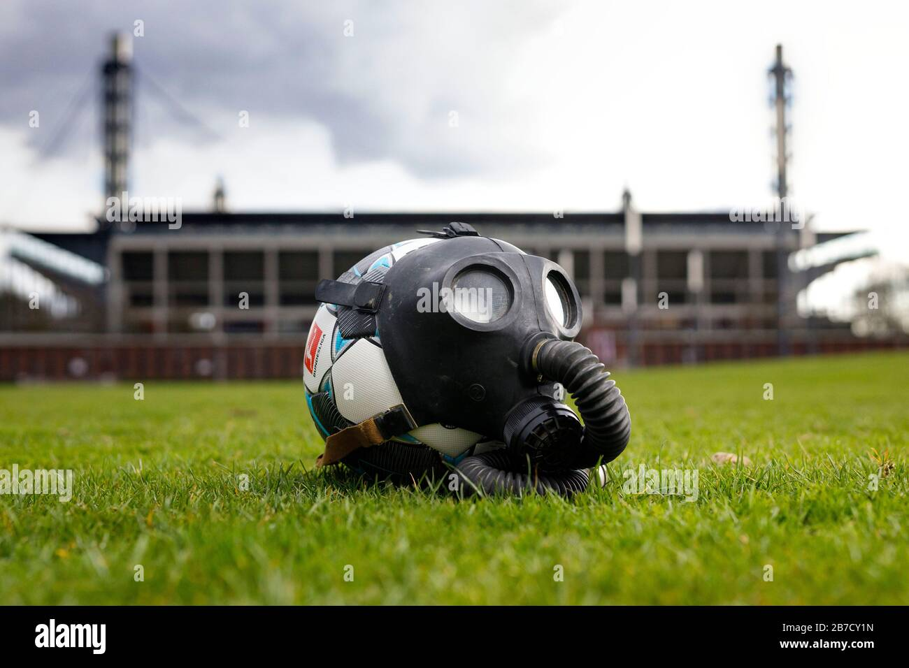 A soccer ball with a gas mask in front of the Rheinenergie Stadium in Cologne (Germany). Stock Photo