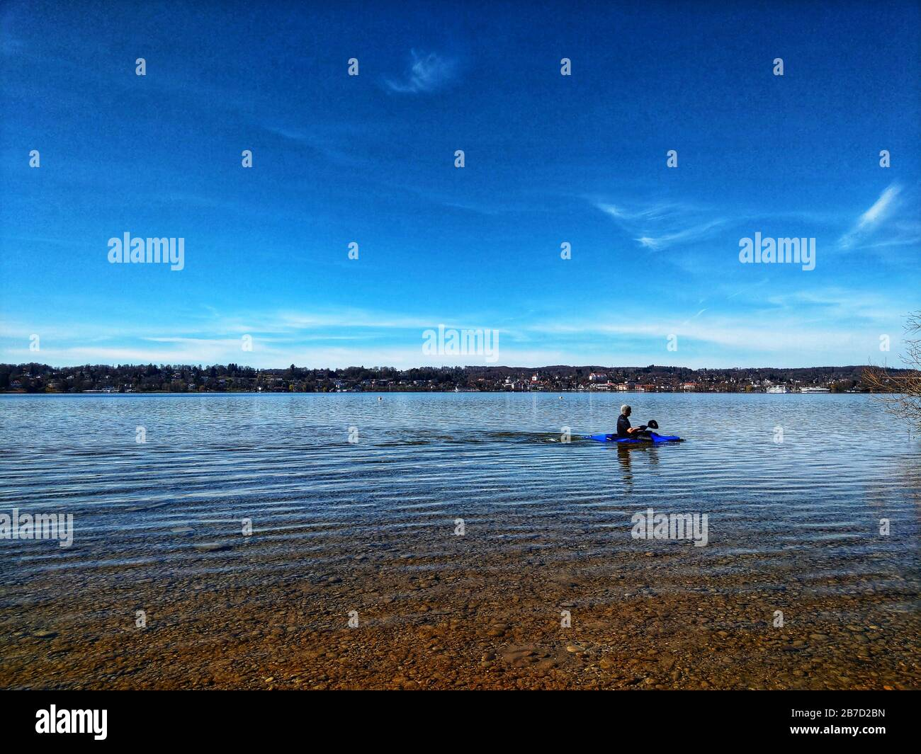 Starnberg, Bavaria, Germany. 15th Mar, 2020. A kayaker on Lake Starnberg near Munich, Germany practices social distancing and flatten the curve during the European Coronavirus outbreak and subsequent measures taken to control the spread. Credit: Sachelle Babbar/ZUMA Wire/Alamy Live News Stock Photo