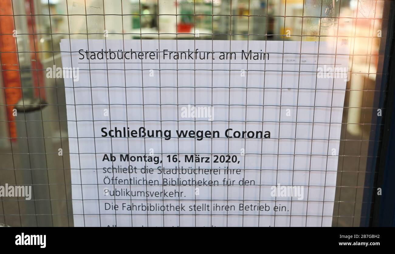 """16 March 2020, Hessen, Frankfurt/Main: """"Closure due to Corona"""" is written on an information sheet attached to the door of the public library in the Saalbau Bornheim. The public libraries are initially closed until 19 April 2020. Photo: Arne Dedert/dpa Stock Photo"""