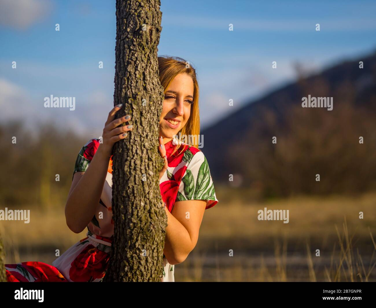 Sunset warm light sidelight sunshine sun-shine sunlight Green forest nature looking away portrait embracing embrace loving liking tree natureaddict Stock Photo