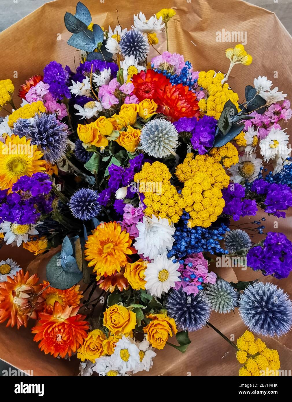 Vibrant Dried Flower Arrangement In Purple And Yellow Tones Stock Photo Alamy