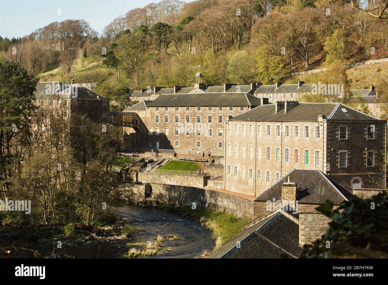View of the village and mills of New Lanark World Heritage Site beside the River Clyde, New Lanark, Scotland Stock Photo