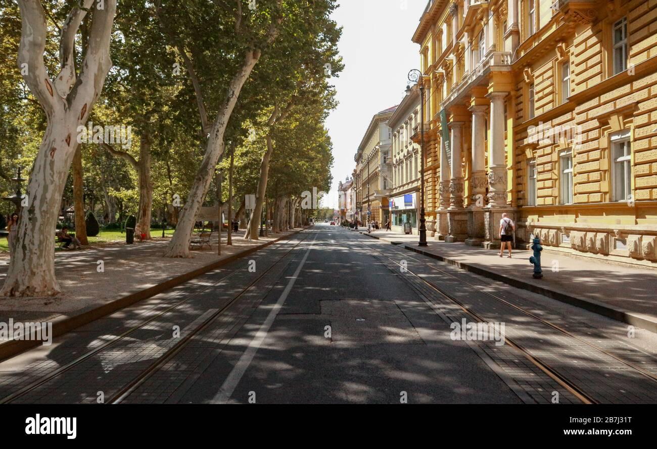Zrinjevac square beautiful green treeline above road and tram railway Stock Photo