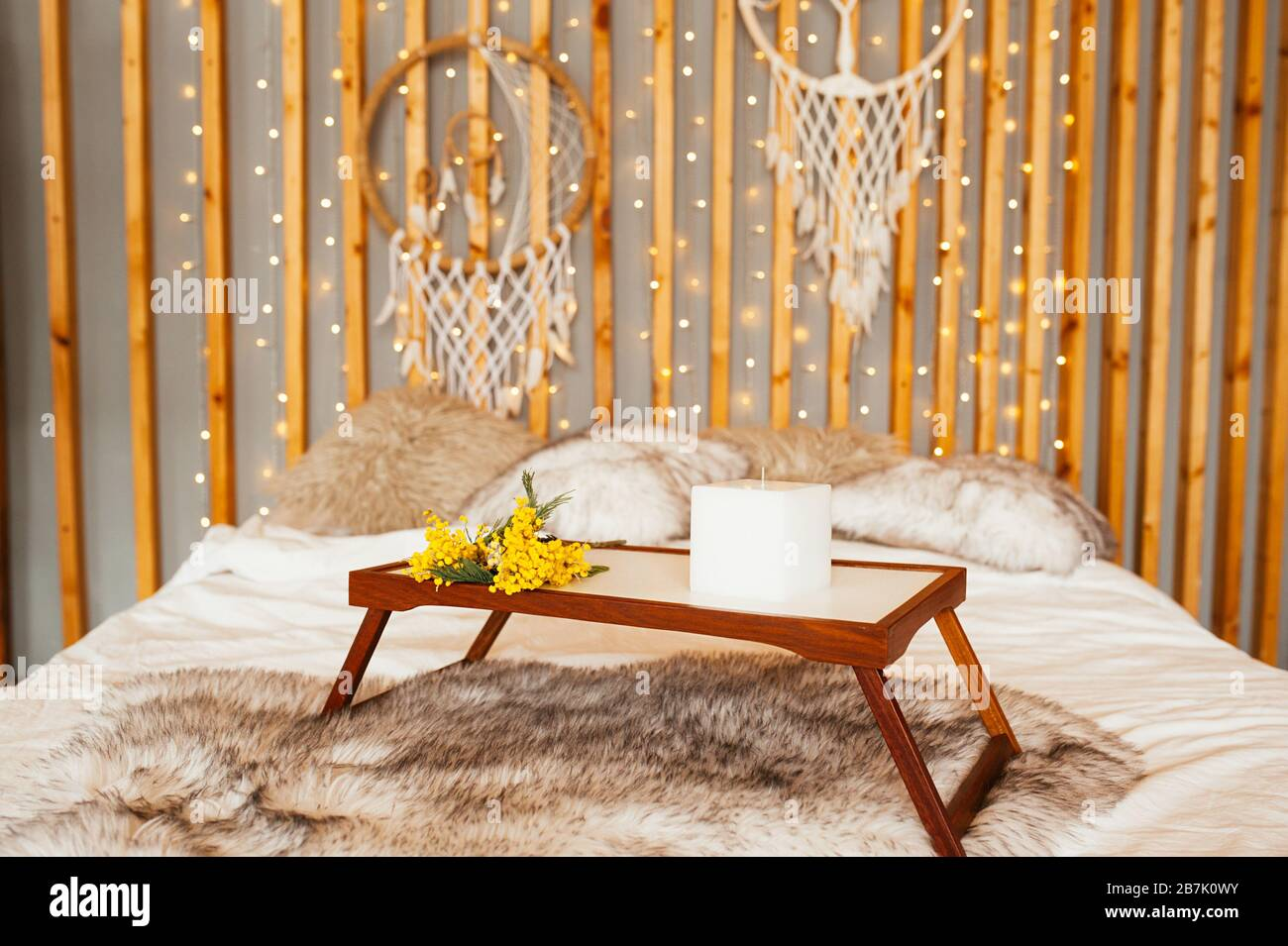 Yellow Mimosa Bouquet On The Wooden Table Breakfast Tray In Bed Boho Bedroom Wooden Wall Decor With Garlands Lamps And Dream Catchers Stock Photo Alamy