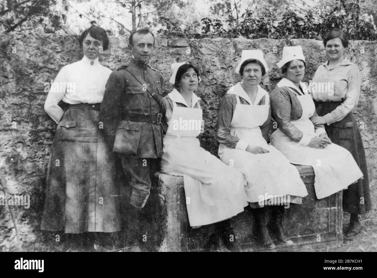 Flu fighters in Montenegro. They went to Montenegro to fight smallpox, and typhus epidemics and when influenza broke out there had their hands full taking care of the victims of the newer epidemic. They belong to the American Red Cross hospital staff in Podgoritza, Montenegro. From left to right they are: Miss Margaret Lena Johnson, Chicago; Major Joseph F. Jaros, Chicago; Miss Mary Theresa Beulhauser, New York; Miss Elizabeth G. Mitchell, Newport R.I. and Dr. Katherine M. Cook, New Wilmington, PA. March 1920 Stock Photo