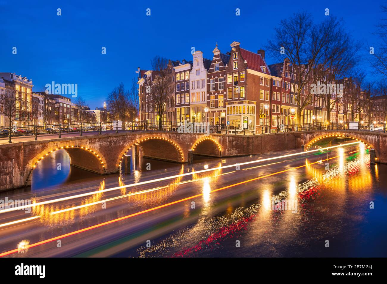 Amsterdam, Netherlands bridges and canals at twilight. Stock Photo