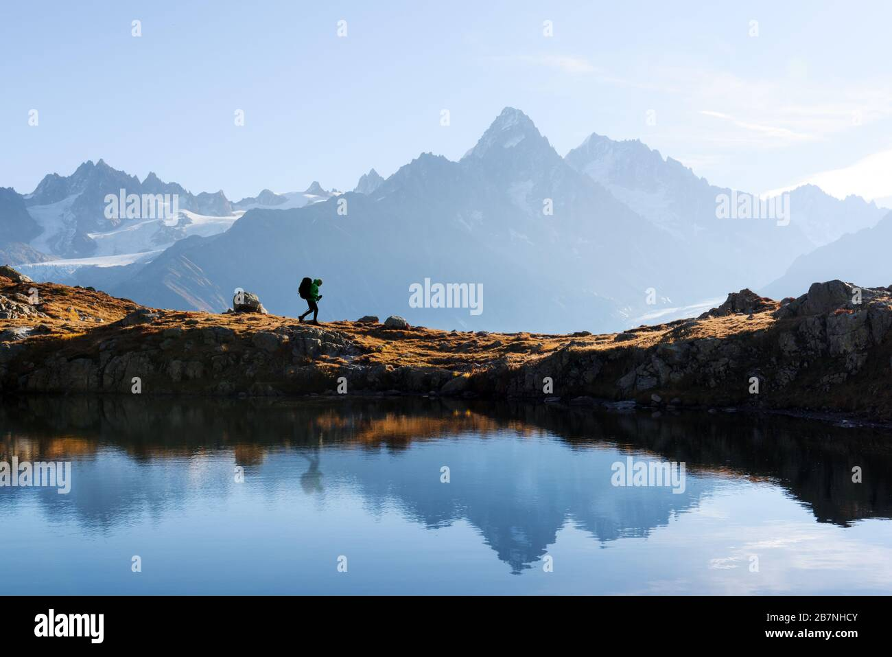Amazing view on Monte Bianco mountains range with tourist on a background. Lac de Cheserys lake, Chamonix, Graian Alps. Landscape photography Stock Photo