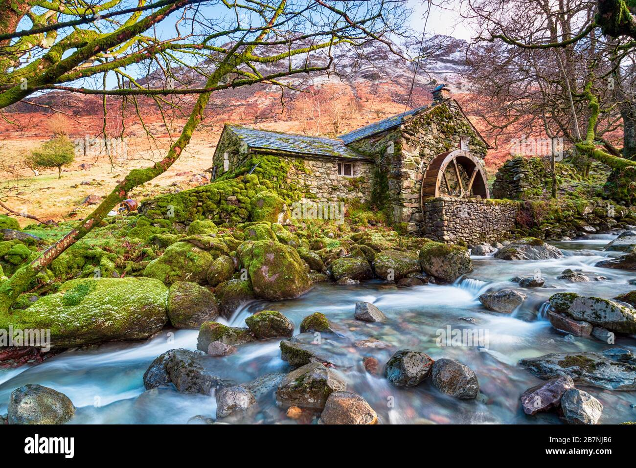 An old water mill on the banks of Combes Gill in Borrowdale valley in the Lake District National Park in Cumbria Stock Photo
