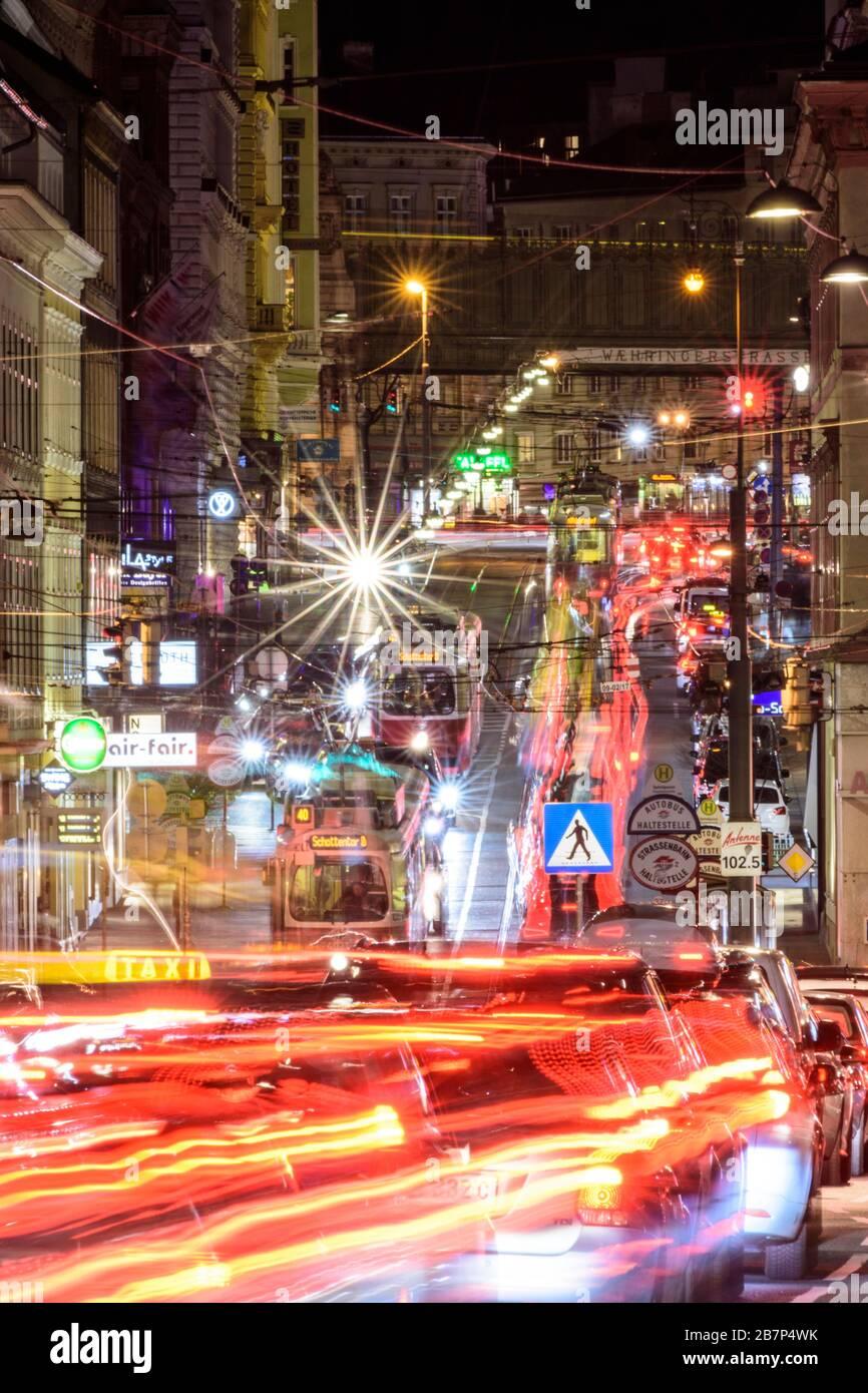 Wien, Vienna: streetcar, cars, car light trails, heavy traffic, rush hour, street Währinger Straße, in 09. Alsergrund, Wien, Austria Stock Photo