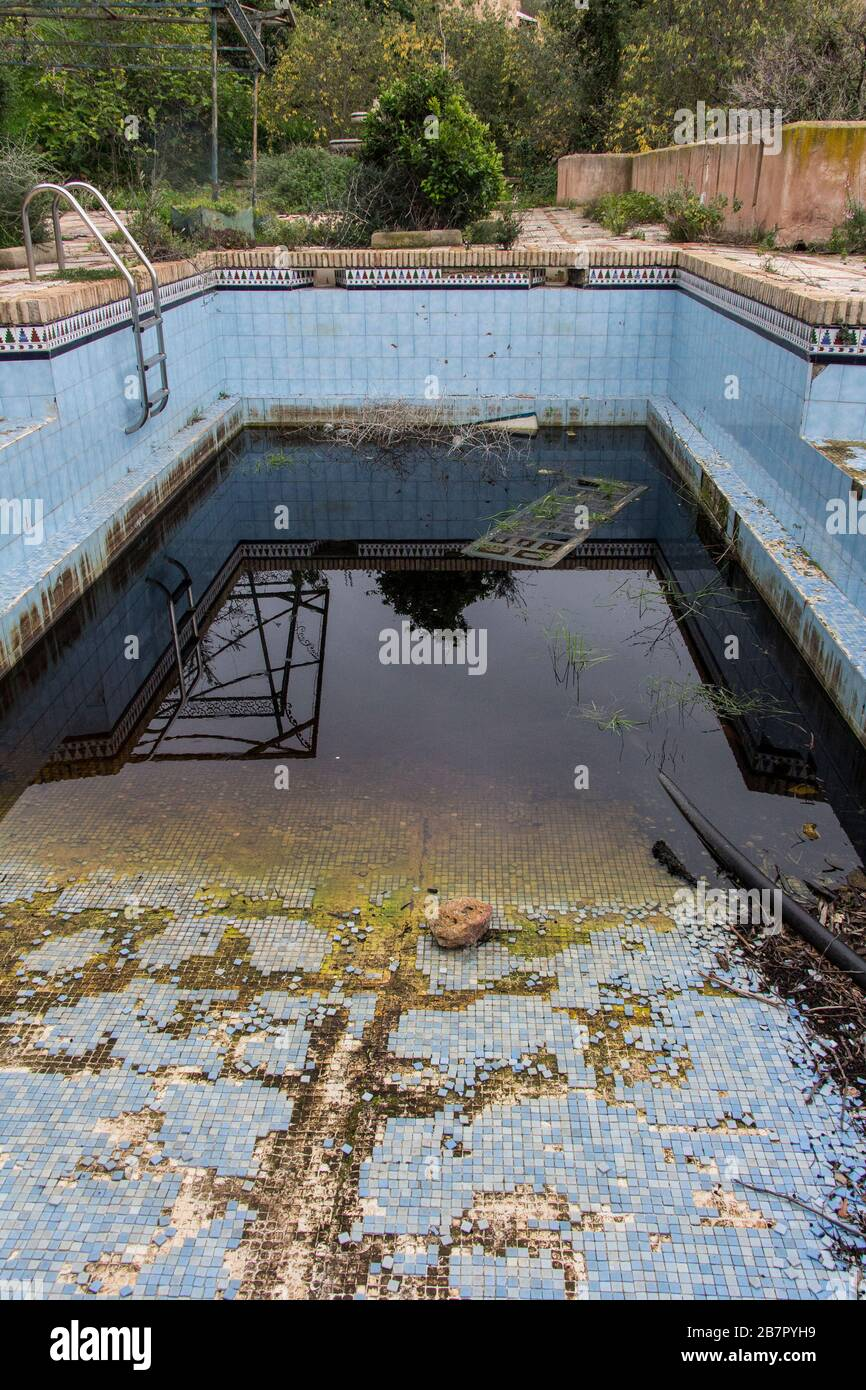 A Dirty And Abandoned Pool With Little Water Abandoned Pool Abandoned Swimming Pool Ruined Pool Stock Photo Alamy