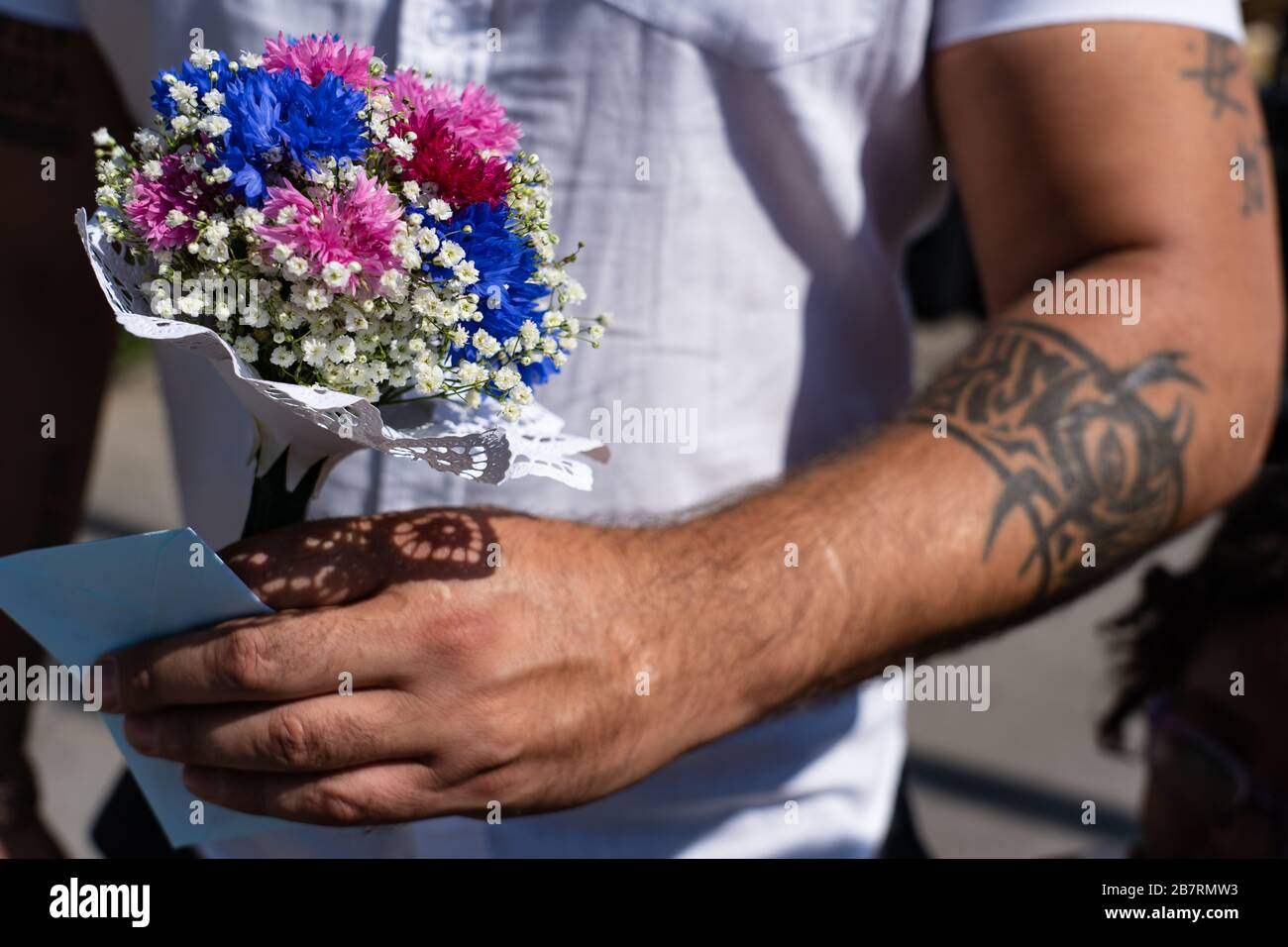 Men With Tattoo Holding Flower Bouquet Of Children In Hand On The 4th Of July At Jugendfest Brugg 2019 Stock Photo Alamy