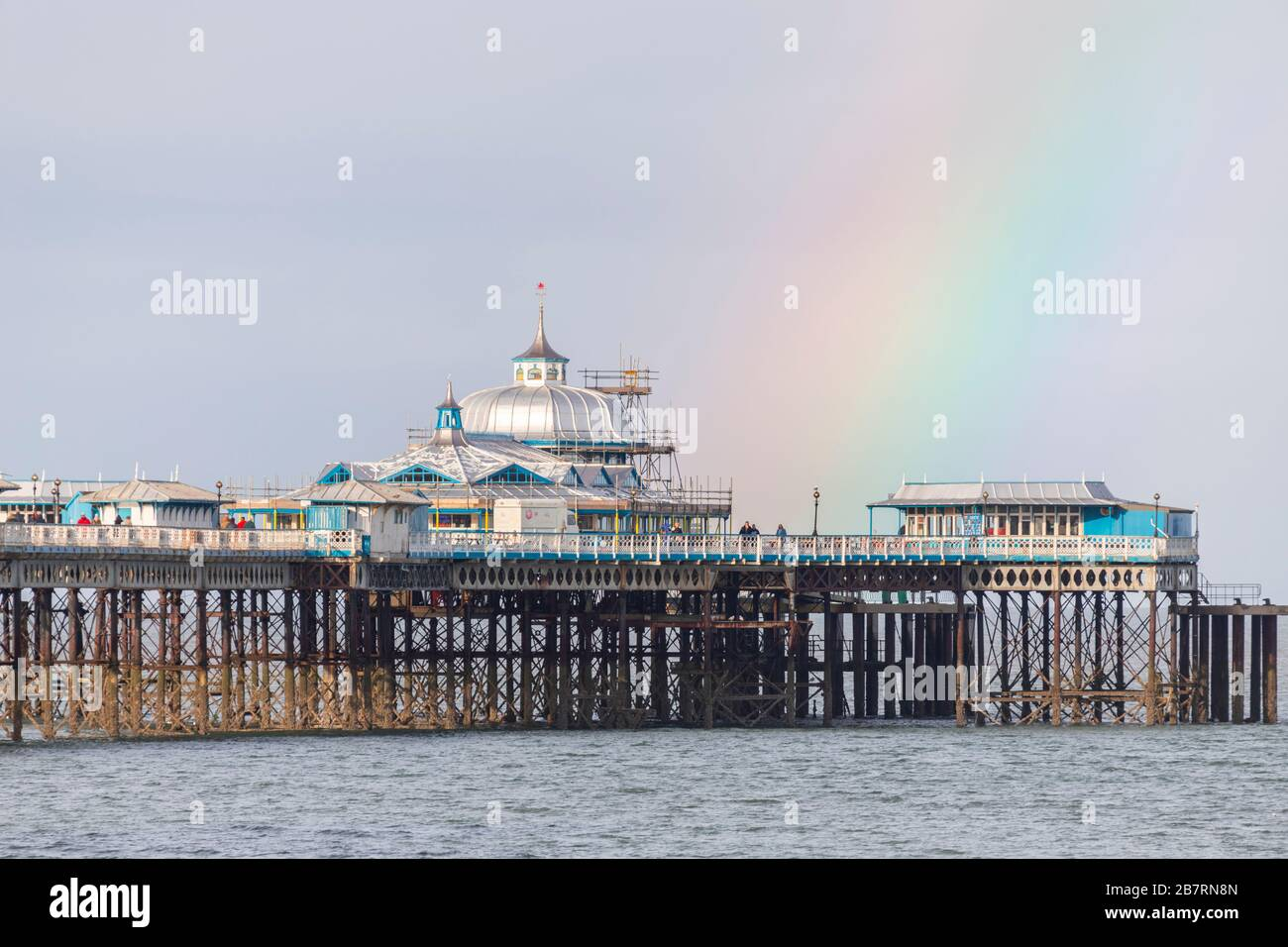 Rainbow over Llandudno Pier on the North Wales coast Stock Photo