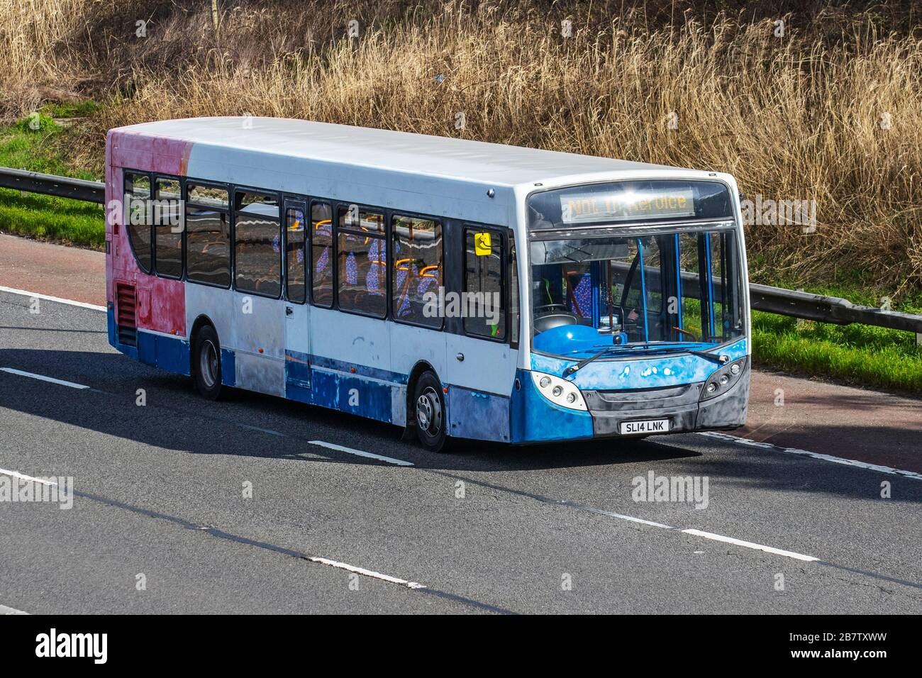 SL14LNK multi-coloured Alexander Dennis Enviro; barn find vehicle restoration project. UK Vehicular traffic derelict condition, old collectible vintage classic transport, single decker old bus, veteran classics on the 3 lane M6 Motorway highway. Stock Photo