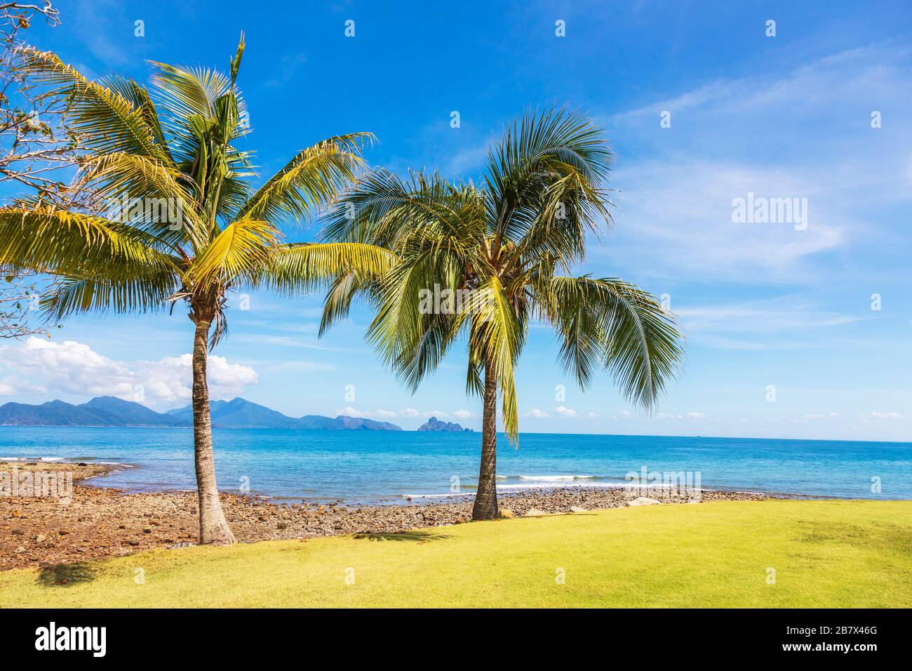 View across the Andaman Sea and  Anak Datai Island from the 16th putting green at the Rainforest Golf Course, The Els Club, Teluk Datai, Langkawi, Stock Photo