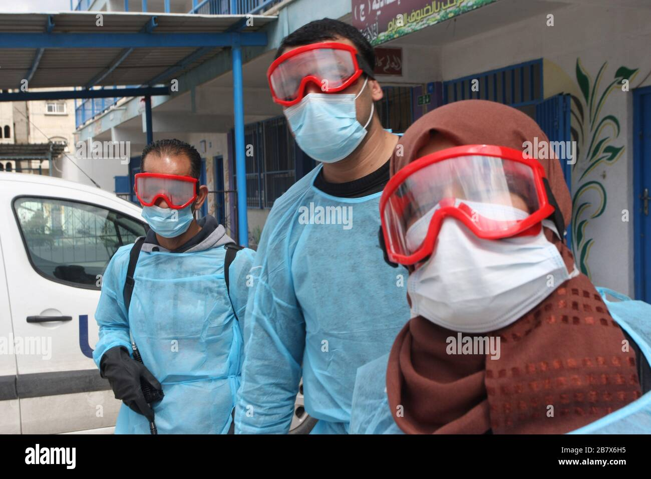 Gaza, Palestine. 18th Mar, 2020. Palestinian health workers wearing a protective facemasks are pictured in the courtyard of a United Nations Relief and Works Agency for Palestinian Refugees (UNRWA) school at Khan Younis refugee camp in southern Gaza on Wednesday, March 18, 2020, as preparations are underway to receive, examine and isolate potential victims of the Covid-19 coronavirus. So far Gaza have not confirmed any infections. But doctors in many cases believe the virus has arrived and fear that a lack of disease surveillance systems - shortages of tests, basic supplies and properly traine Stock Photo
