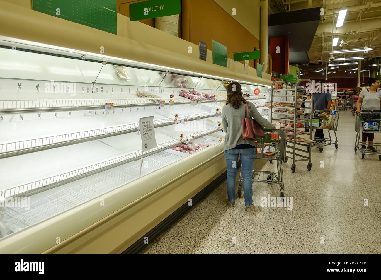 Orlando, FL/USA-3/14//20: Empty meat display shelves at a Publix grocery store due to the people panicking and hoarding paper and food products. Stock Photo