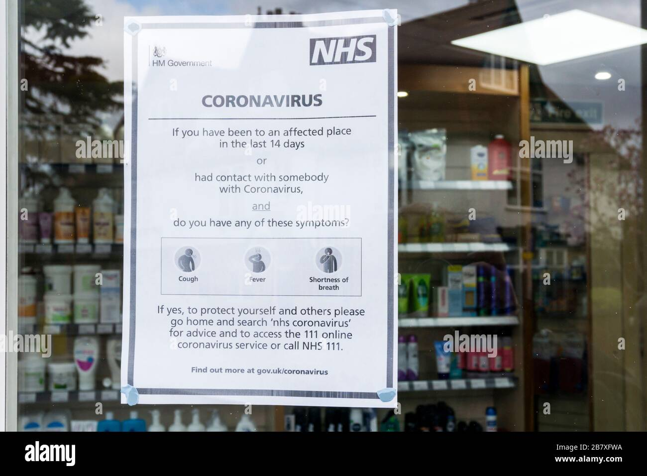 18 March 2020. Bromley, South London, UK.  Sign on a chemist's shop gives instructions to people who may have been in contact with the Covid 19 Coronavirus.  Credit UrbanImages-news/Alamy Stock Photo